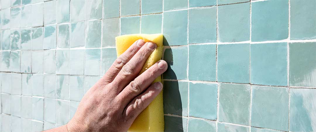 After drying, remove excess cement